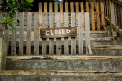 Wooden Closed sign. Closed sign on old wooden fence royalty free stock image