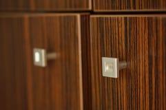 Wooden closet. Handles of wooden closet doors stock image