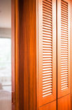 Wooden closet with mirror partition Royalty Free Stock Image