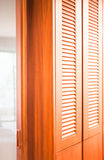 Wooden closet and translucent mirror partition Royalty Free Stock Images