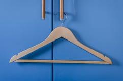 Wooden cloth hanger hanging on door handle Royalty Free Stock Photography