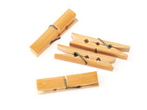 Wooden cloth pegs isolated on white background. Wooden clothes pegs isolated on white background Royalty Free Stock Photos
