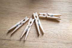 Wooden cloth pegs. On wooden table Stock Images