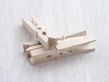 Wooden Cloth Pegs. On wood Background Royalty Free Stock Photo