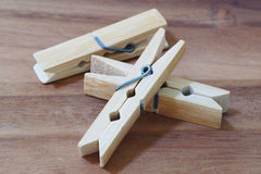 Wooden cloth pegs on wooden background. Wooden cloth pegs on wood background Stock Photos
