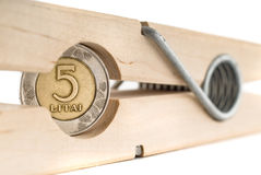 Wooden clothe spin with a coin in it Stock Image
