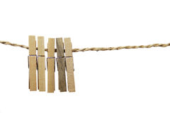 Wooden clothes clips. Isolated on rope Royalty Free Stock Photography
