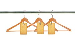 Wooden clothes hangers with blank tags isolated on white Stock Photography