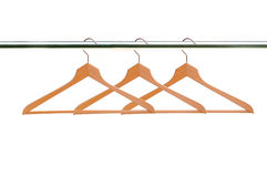 Wooden clothes hangers isolated on white Royalty Free Stock Photo