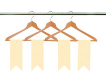 Wooden clothes hangers with tags (labels) isolated on white royalty free stock image