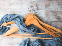 Wooden clothes hangers. What to wear. Wooden clothes hangers on bright background. What nothing to wear concept. Woman clothing Royalty Free Stock Images