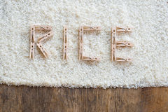 Wooden clothes peg Arrange the words. Wooden Colorful clothes peg Arrange the words RICE on rice background stock image