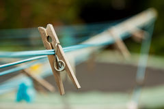 Wooden clothes peg on a washing line Stock Images