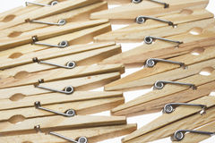 Wooden clothes peg. On a white background royalty free stock photo