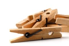 Wooden clothes pegs for clothes drying Stock Images