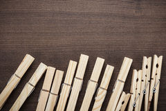 Wooden clothes pegs on the table Royalty Free Stock Photography