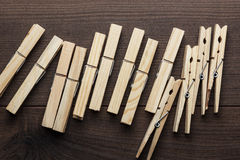 Wooden clothes pegs on the table Royalty Free Stock Photos