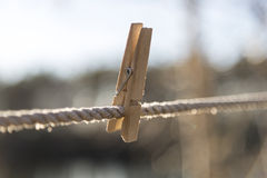Wooden Clothes Pin on Clothes Line. Close up Stock Photography