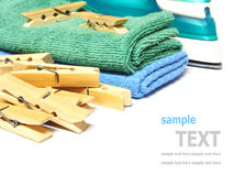 Wooden clothes pin and iron laundered fabric isolated on white Stock Images