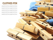 Wooden clothes pin and laundered denim fabric  on white Royalty Free Stock Photos