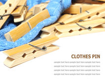 Wooden clothes pin and laundered denim fabric  on white Stock Photo