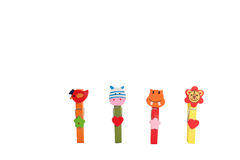 Wooden clothes pin multi-colored animals. Royalty Free Stock Image