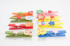 Wooden clothes pin multi-colored animals. Stock Photo