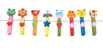 Wooden clothes pin multi-colored animals. Stock Image