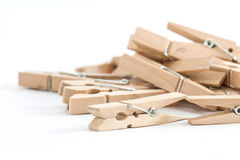 Wooden clothes pins, isolated on a white background Stock Photography