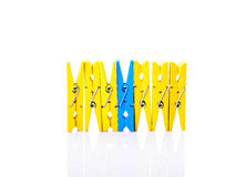 Wooden clothes pins on a white Royalty Free Stock Photo