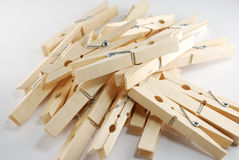Wooden clothespin. The wooden clothespin pile up on the white background Royalty Free Stock Photo