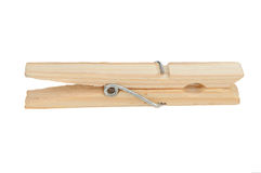 Wooden Clothespin. A wooden clothespin isolated on a white background Stock Image