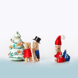 Wooden clothespin family with kid and Santa Claus Royalty Free Stock Photography