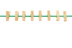 Wooden clothespin and green rope isolated. On white background royalty free stock photos