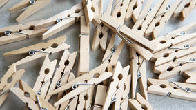Wooden clothespin on grey background. Many wooden clothespin on gray background Stock Photos