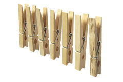 Wooden clothespins. Some wooden clothespins on a white background royalty free stock photo