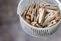 Wooden clothespins in the basket, blur, bright photo. The concept of eco-consumption, the use of natural materials, awareness.  stock photography
