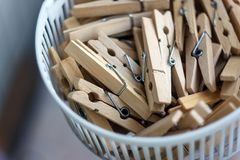 Wooden clothespins in the basket, blur, bright photo. The concept of eco-consumption, the use of natural materials, awareness.  stock images