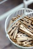 Wooden clothespins in the basket, blur, bright photo. The concept of eco-consumption, the use of natural materials, awareness royalty free stock images