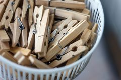 Wooden clothespins in the basket, blur, bright photo. The concept of eco-consumption, the use of natural materials, awareness stock image