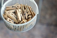 Wooden clothespins in the basket, blur, bright photo. The concept of eco-consumption, the use of natural materials, awareness.  royalty free stock image