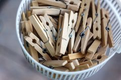 Wooden clothespins in the basket, blur, bright photo. The concept of eco-consumption, the use of natural materials, awareness.  royalty free stock photos