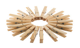 Wooden clothespins in circle Royalty Free Stock Photos
