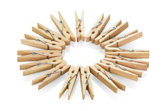 Wooden clothespins close-up isolated on white. Stock Photography