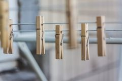 Wooden clothespins on a clothesline, blur, light photo. The concept of eco-consumption, the use of natural materials, awareness.  stock photos