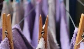 Wooden clothespins on a clothesline stock photos