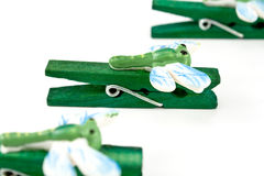 Wooden clothespins decorated with dragonflies Stock Photography