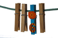 Wooden clothespins hanging on a rope Royalty Free Stock Photo
