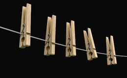 Wooden clothespins on rope Royalty Free Stock Image