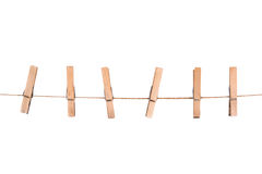 Wooden clothespins on a rope Stock Images